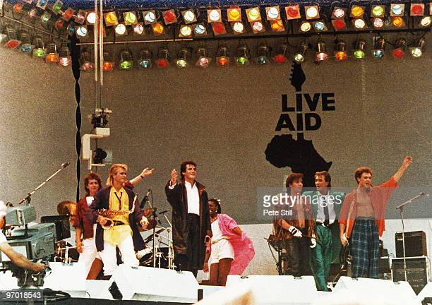 Steve Norman Tony Hadley John Keeble Martin Kemp and Gary Kemp of Spandau Ballet wave farewell to the crowd after performing on stage at Live Aid in...