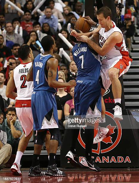 TORONTO ON OCTOBER 9 Steve Novak fouls Minnesota Timberwolves power forward Derrick Williams as the Toronto Raptors play the Minnesota Timberwolves...