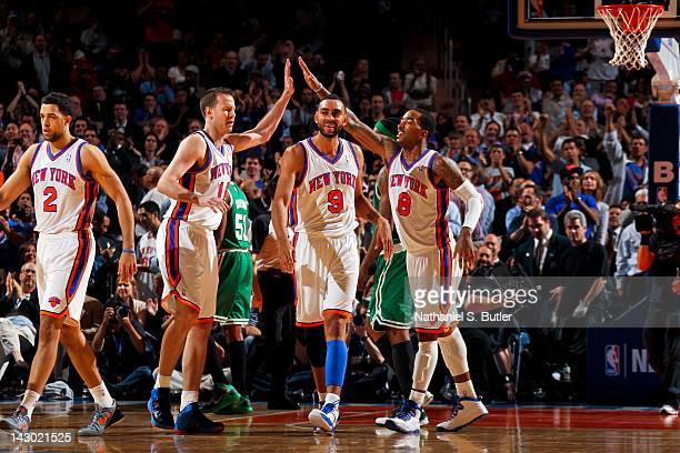 Steve Novak Jared Jeffries and JR Smith of the New York Knicks celebrate during a game against the Boston Celtics on April 17 2012 at Madison Square...