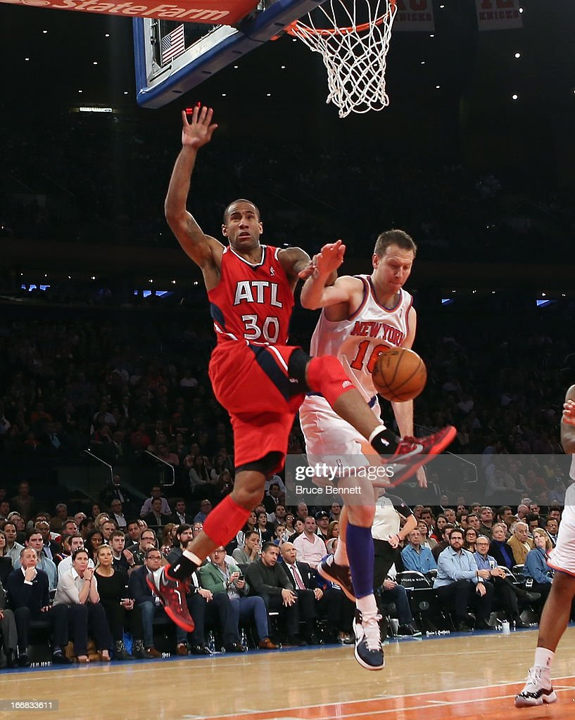 Steve Novak #16 of the New York Knicks fouls Dahntay Jones #30 of the Atlanta Hawks in the first quarter at Madison Square Garden on April 17, 2013 in New York City.