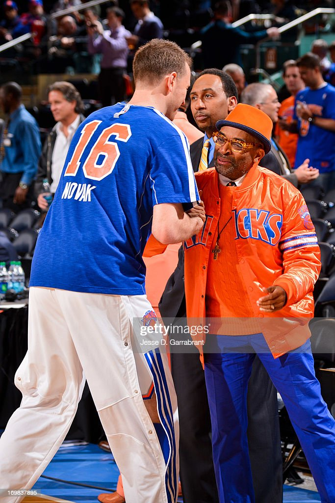 Steve Novak #16 of the New York Knicks greets director Spike Lee before playing against the Boston Celtics in Game Five of the Eastern Conference Quarterfinals during the 2013 NBA Playoffs on May 1, 2013 at Madison Square Garden in New York City