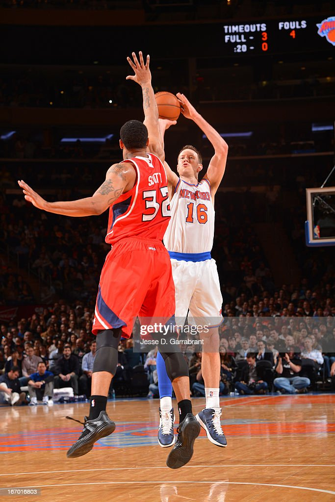 Steve Novak #16 of the New York Knicks shoots the ball against Mike Scott #32 of the Atlanta Hawks on April 17, 2013 at Madison Square Garden in New York City, New York.