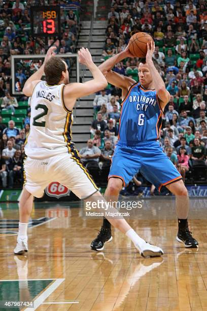 Steve Novak of the Oklahoma City Thunder handles the ball against Joe Ingles of the Utah Jazz on March 28 2015 at EnergySolutions Arena in Salt Lake...