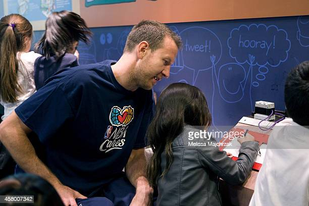 Steve Novak of the Utah Jazz draws with a young fan during the Jackson Elementary School field trip to Discovery Gateway Children's Museum on October...