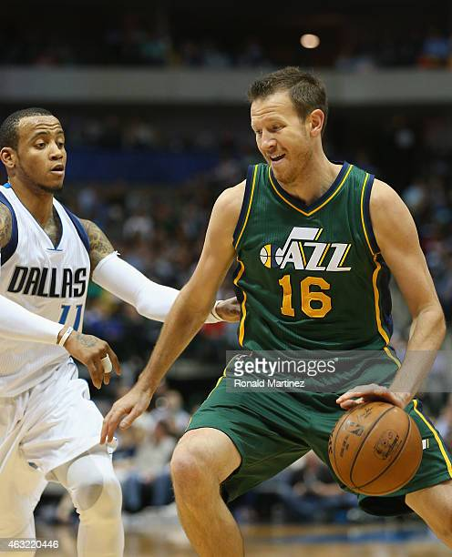 Steve Novak of the Utah Jazz dribbles the ball against Monta Ellis of the Dallas Mavericks at American Airlines Center on February 11 2015 in Dallas...
