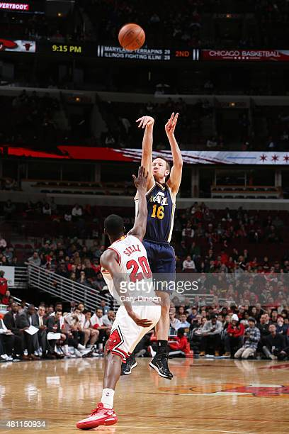 Steve Novak of the Utah Jazz shoots against Tony Snell of the Chicago Bulls during the game on January 7 2015 at United Center in Chicago Illinois...