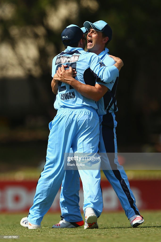Steve O'Keefe and <a gi-track='captionPersonalityLinkClicked' href=/galleries/search?phrase=Ed+Cowan&family=editorial&specificpeople=2207390 ng-click='$event.stopPropagation()'>Ed Cowan</a> of the Blues celebrate after Cowan took the catch to remove William Bosisto of the Cricket Australia XI during the Matador BBQs One Day Cup match between New South Wales and the Cricket Australia XI at Bankstown Oval on October 5, 2015 in Sydney, Australia.