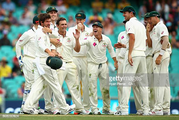 Steve O'Keefe and Joe Burns of Australia celebrate after combining to dismiss Jason Holder of West Indies during day one of the third Test match...