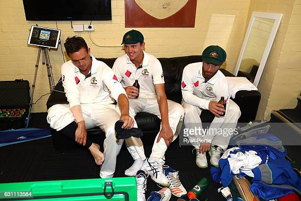 Steve O'Keefe Josh Hazlewood and Matthew Wade of Australia celebrate in the change rooms after day five of the Third Test match between Australia and...