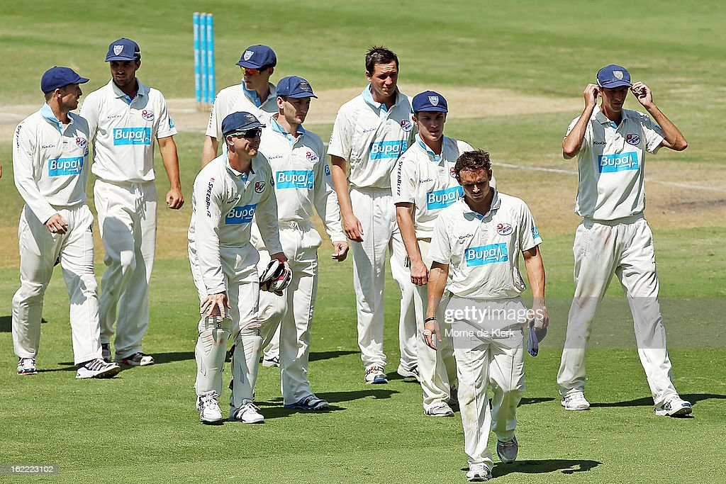 Steve O'Keefe leads Blues players from the field after day three of the Sheffield Shield match between the South Australian Redbacks and the New South Wales Blues at Adelaide Oval on February 21, 2013 in Adelaide, Australia.