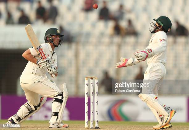 Steve O'Keefe of Australia and Mushfiqur Rahim of Bangladesh watch the ball during day three of the Second Test match between Bangladesh and...