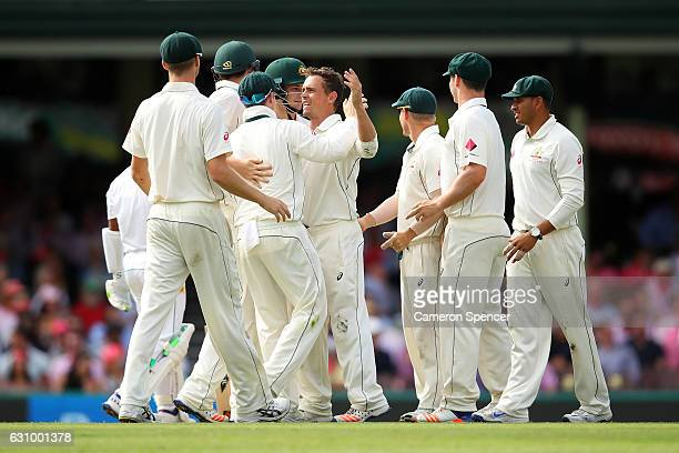 Steve O'Keefe of Australia celebrates with team mates after dismissing Asad Shafiq of Pakistan during day three of the Third Test match between...