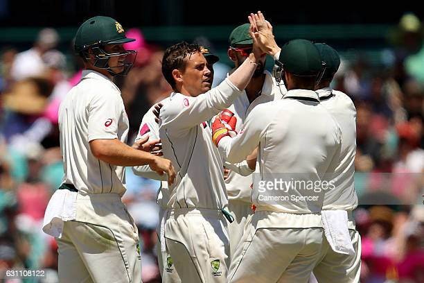 Steve O'Keefe of Australia celebrates with team mates after dismissing Yasir Shah of Pakistan during day five of the Third Test match between...