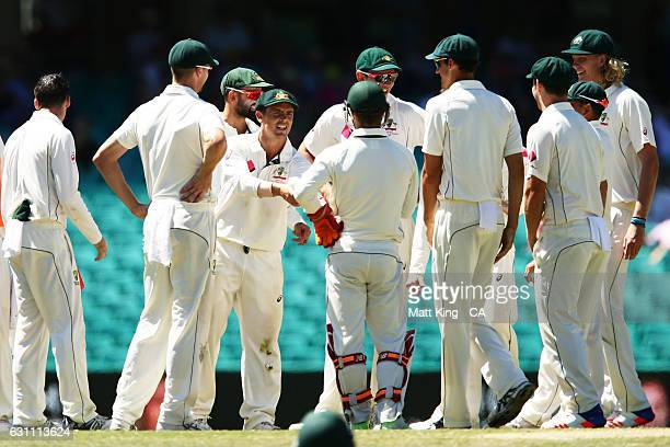 Steve O'Keefe of Australia celebrates with team mates after running out Mohammad Amir of Pakistan during day five of the Third Test match between...