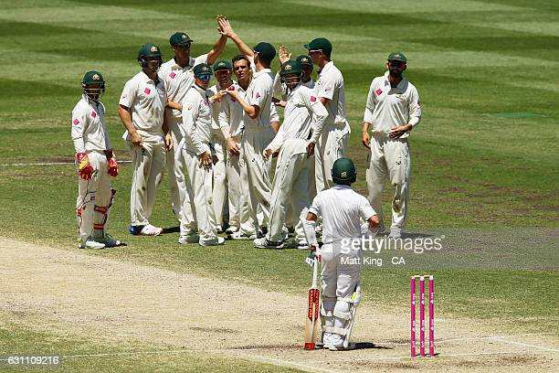 Steve O'Keefe of Australia celebrates with team mates after taking the wicket of Yasir Shah of Pakistan during day five of the Third Test match...