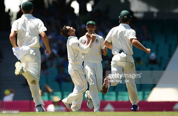 Steve O'Keefe of Australia celebrates with team mates after taking the wicket of MisbahulHaq of Pakistan during day five of the Third Test match...