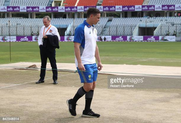 Steve O'Keefe of Australia inspects the pitch during day one of the Second Test match between Bangladesh and Australia at Zahur Ahmed Chowdhury...