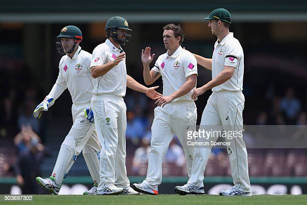 Steve O'Keefe of Australia is congratulated after dismissing Denesh Ramdin of West Indies during day five of the third Test match between Australia...
