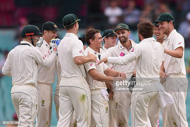 Steve O'Keefe of Australia is congratulated by team mates after dismissing Jason Holder of West Indies caught by Joe Burns during day one of the...