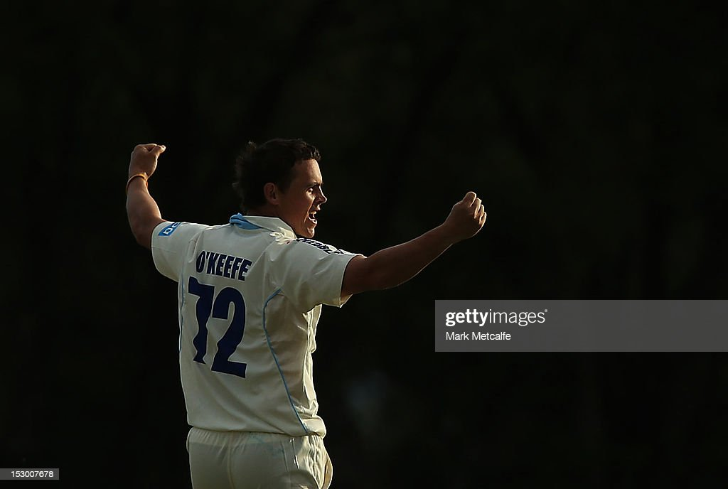 Steve O'Keefe of New South Wales celebrates taking the wicket of Tim Paine of Tasmania during day four of the Sheffield Shield match between the New South Wales Blues and the Tasmanian Tigers at Bankstown Oval on September 29, 2012 in Sydney, Australia.