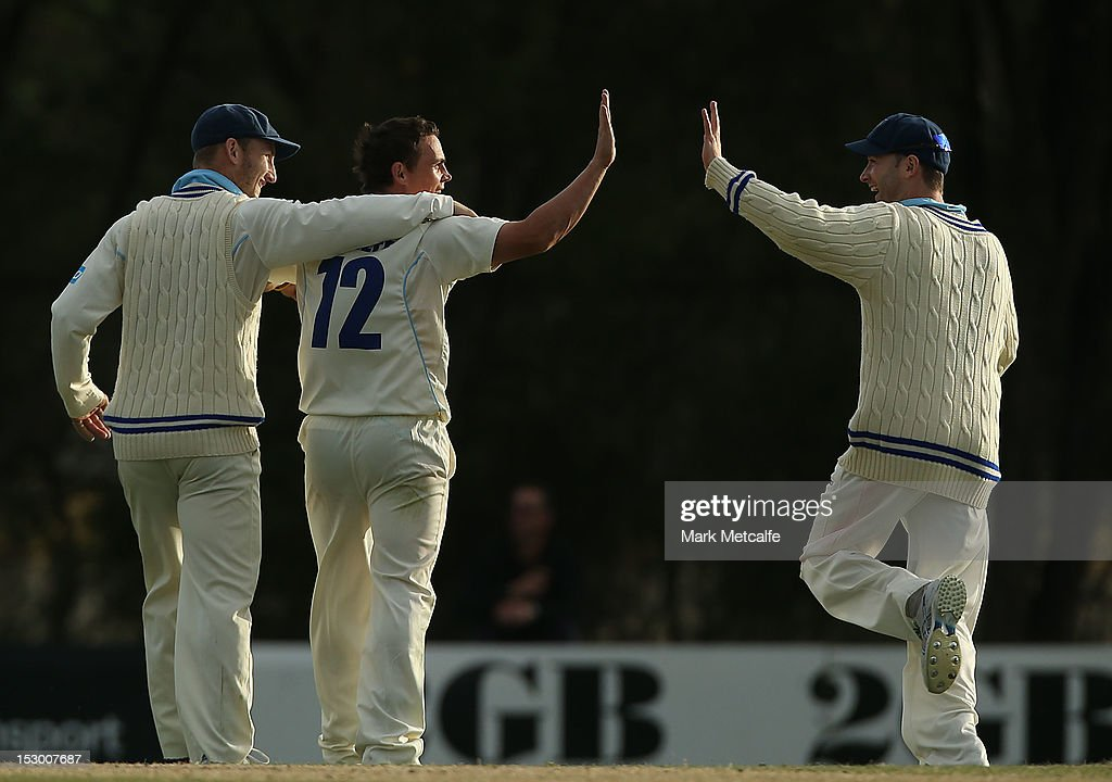 Steve O'Keefe of New South Wales celebrates with teammates Michael Clarke and Peter Nevill after taking the wicket of Tim Paine of Tasmania during day four of the Sheffield Shield match between the New South Wales Blues and the Tasmanian Tigers at Bankstown Oval on September 29, 2012 in Sydney, Australia.