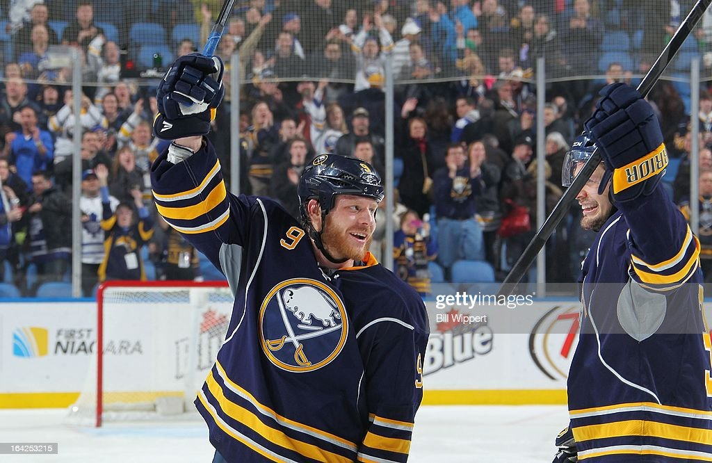 Steve Ott #9 and Patrick Kaleta #36 of the Buffalo Sabres celebrate a 5-4 shootout victory over the Toronto Maple Leafs on March 21, 2013 at the First Niagara Center in Buffalo, New York.
