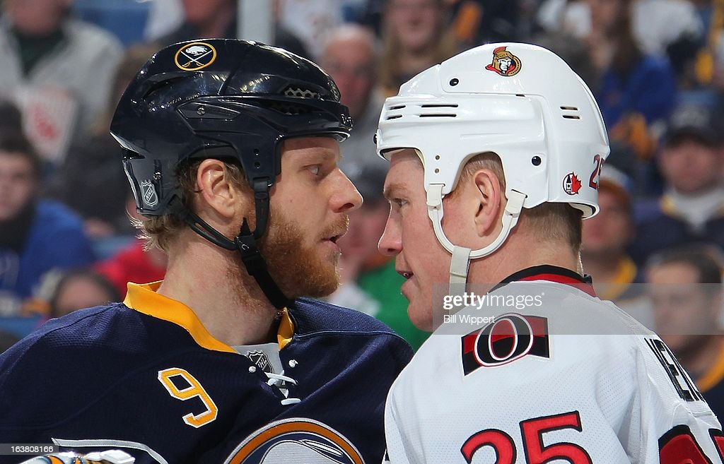 <a gi-track='captionPersonalityLinkClicked' href=/galleries/search?phrase=Steve+Ott&family=editorial&specificpeople=210616 ng-click='$event.stopPropagation()'>Steve Ott</a> #9 of the Buffalo Sabres and Chris Neil #25 of the Ottawa Senators exchange words between face-offs on March 16, 2013 at the First Niagara Center in Buffalo, New York.