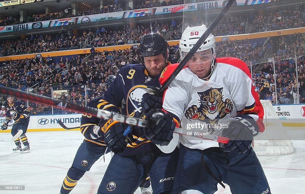 Steve Ott #9 of the Buffalo Sabres and Drew Shore #50 of the Florida Panthers tie up their sticks as they battle for a puck along the boards on February 3, 2013 at the First Niagara Center in Buffalo, New York.