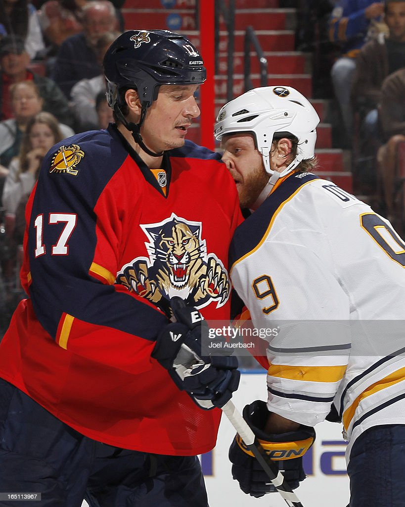 Steve Ott #9 of the Buffalo Sabres and Filip Kuba #17 of the Florida Panthers collide in front of the net at the BB&T Center on March 28, 2013 in Sunrise, Florida. The Panthers defeated the Sabres 5-4 in a shoot out.