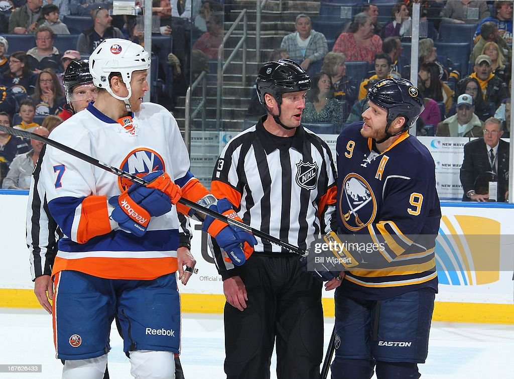 Steve Ott #9 of the Buffalo Sabres and Matt Carkner #7 of the New York Islanders both grab hold of Carkner's hockey stick on April 26, 2013 at the First Niagara Center in Buffalo, New York. The Sabres defeated the Islanders 2-1.