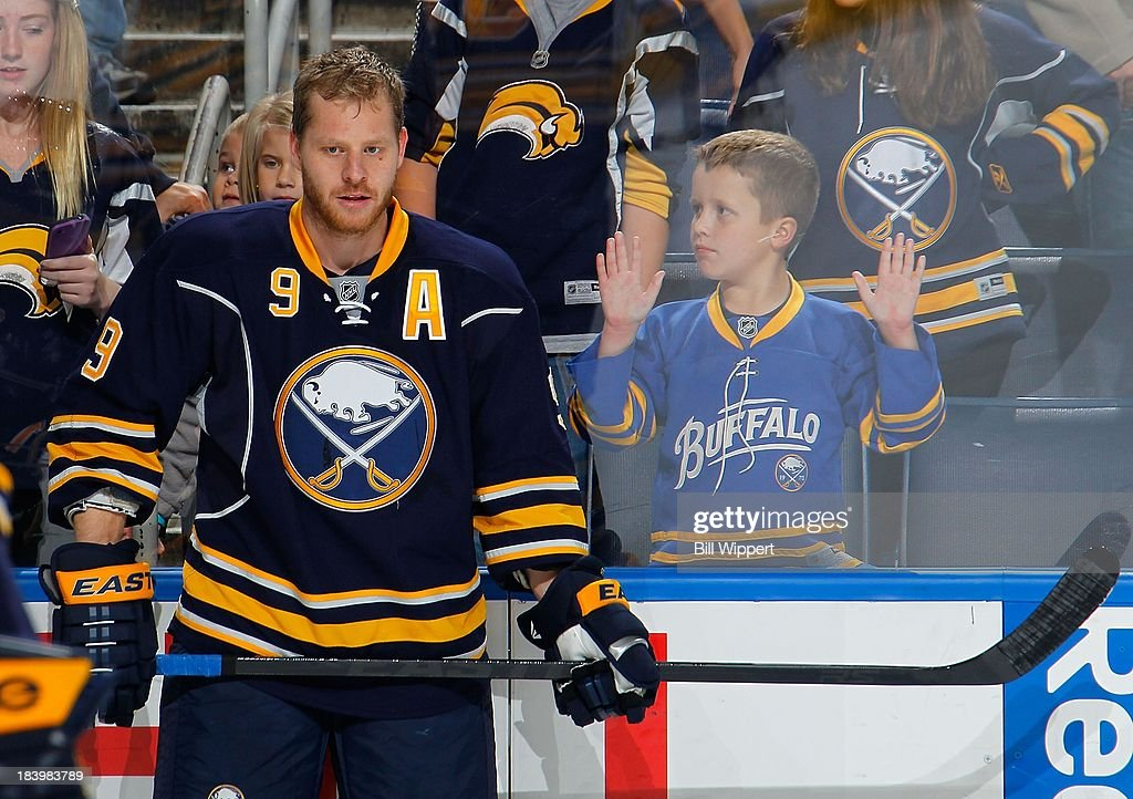 Steve Ott #9 of the Buffalo Sabres attracts the attention of front row fans before their game against the Columbus Blue Jackets on October 10, 2013 at the First Niagara Center in Buffalo, New York.