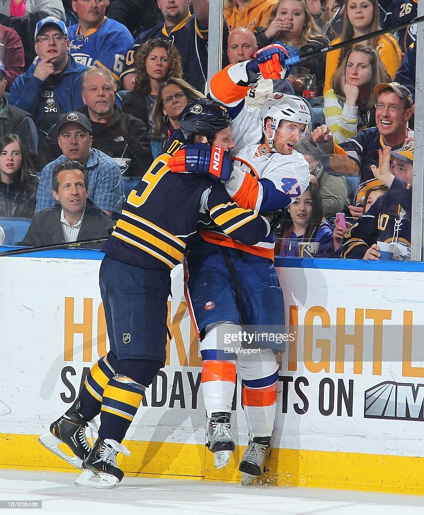 Steve Ott #9 of the Buffalo Sabres battles along the boards with Andrew MacDonald #47 of the New York Islanders on April 26, 2013 at the First Niagara Center in Buffalo, New York. The Sabres defeated the Islanders 2-1.