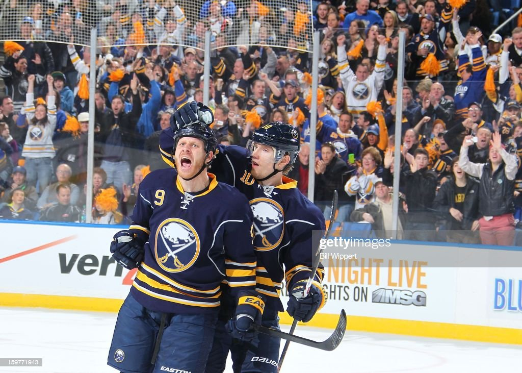 Steve Ott #9 of the Buffalo Sabres celebrates his first period goal with teammate Christian Ehrhoff #10 against the Philadelphia Flyers on January 20, 2013 at the First Niagara Center in Buffalo, New York.