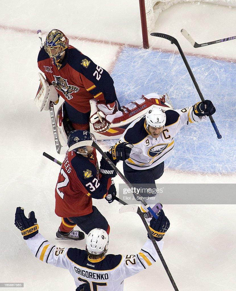 <a gi-track='captionPersonalityLinkClicked' href=/galleries/search?phrase=Steve+Ott&family=editorial&specificpeople=210616 ng-click='$event.stopPropagation()'>Steve Ott</a> #9 of the Buffalo Sabres celebrates his goal with teammates against goaltender <a gi-track='captionPersonalityLinkClicked' href=/galleries/search?phrase=Jacob+Markstrom&family=editorial&specificpeople=5370948 ng-click='$event.stopPropagation()'>Jacob Markstrom</a> #25 of the Florida Panthers at the BB&T Center on October 25, 2013 in Sunrise, Florida.