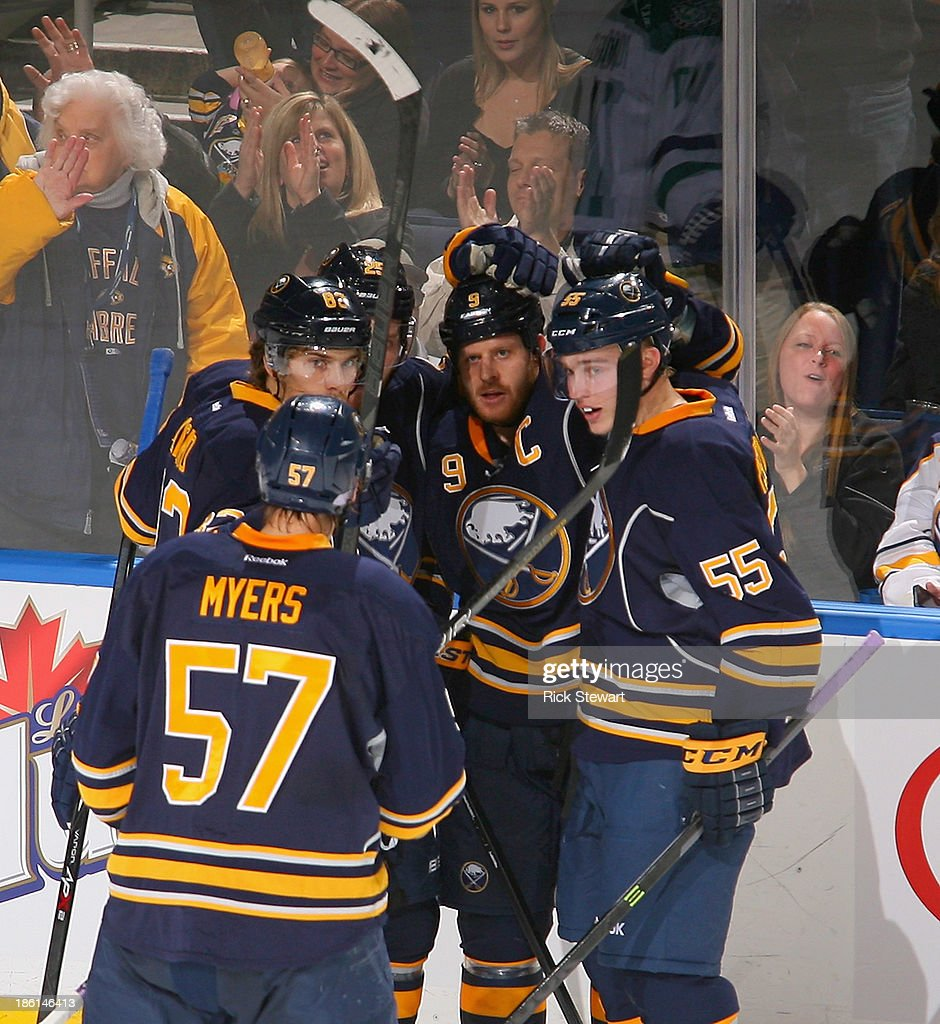 Steve Ott #9 of the Buffalo Sabres celebrates with teammates after scoring Buffalo's second goal against the Dallas Stars at First Niagara Center on October 28, 2013 in Buffalo, New York.