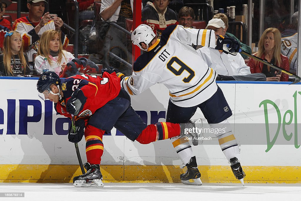 Steve Ott #9 of the Buffalo Sabres defends against Kris Versteeg #32 of the Florida Panthers along the boards at the BB&T Center on October 25, 2013 in Sunrise, Florida.