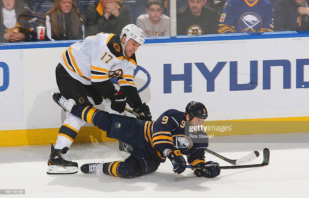<a gi-track='captionPersonalityLinkClicked' href=/galleries/search?phrase=Steve+Ott&family=editorial&specificpeople=210616 ng-click='$event.stopPropagation()'>Steve Ott</a> #9 of the Buffalo Sabres falls as he shoots against <a gi-track='captionPersonalityLinkClicked' href=/galleries/search?phrase=Milan+Lucic&family=editorial&specificpeople=537957 ng-click='$event.stopPropagation()'>Milan Lucic</a> #17 of the Boston Bruins at First Niagara Center on March 31, 2013 in Buffalo, New York. Boston won 2-0.