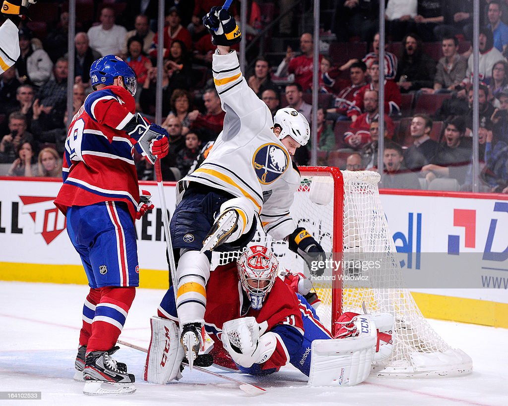 Steve Ott #9 of the Buffalo Sabres falls on top of Carey Price #31 of the Montreal Canadiens after scoring the game winning goal during the NHL game at the Bell Centre on March 19, 2013 in Montreal, Quebec, Canada. The Sabres defeated the Canadiens 3-2 in overtime.