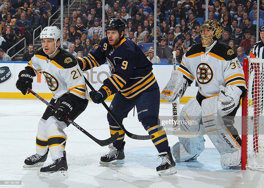 Steve Ott #9 of the Buffalo Sabres gets between Andrew Ference #21 and Anton Khudobin #35 of the Boston Bruins on February 15, 2013 at the First Niagara Center in Buffalo, New York.
