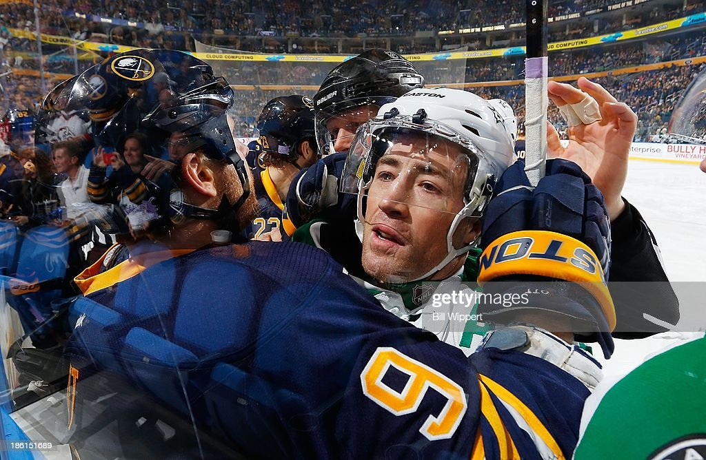 <a gi-track='captionPersonalityLinkClicked' href=/galleries/search?phrase=Steve+Ott&family=editorial&specificpeople=210616 ng-click='$event.stopPropagation()'>Steve Ott</a> #9 of the Buffalo Sabres grabs hold of <a gi-track='captionPersonalityLinkClicked' href=/galleries/search?phrase=Stephane+Robidas&family=editorial&specificpeople=206166 ng-click='$event.stopPropagation()'>Stephane Robidas</a> #3 of the Dallas Stars as they battle along the glass on October 28, 2013 at the First Niagara Center in Buffalo, New York.