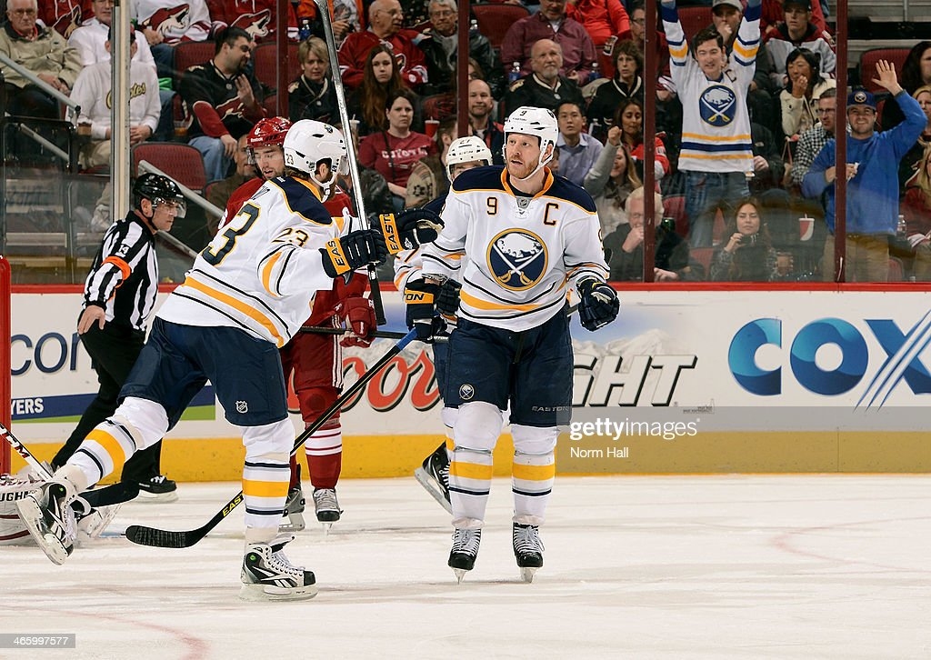 <a gi-track='captionPersonalityLinkClicked' href=/galleries/search?phrase=Steve+Ott&family=editorial&specificpeople=210616 ng-click='$event.stopPropagation()'>Steve Ott</a> #9 of the Buffalo Sabres is congratulated by teammate <a gi-track='captionPersonalityLinkClicked' href=/galleries/search?phrase=Ville+Leino&family=editorial&specificpeople=4025199 ng-click='$event.stopPropagation()'>Ville Leino</a> #23 after his second period goal against the Phoenix Coyotes at Jobing.com Arena on January 30, 2014 in Glendale, Arizona.