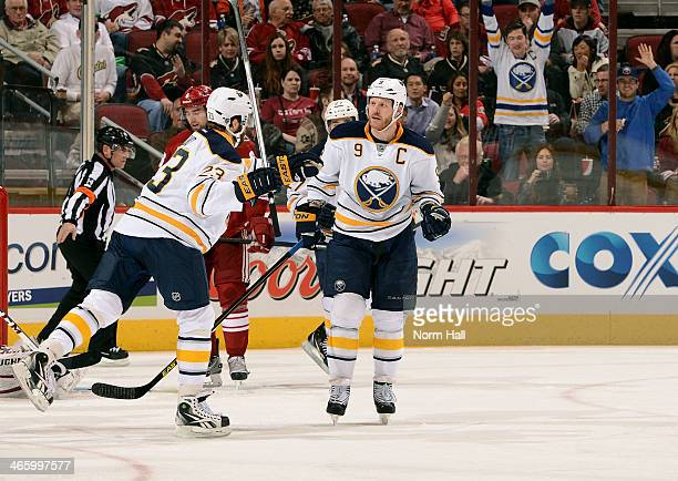 Steve Ott of the Buffalo Sabres is congratulated by teammate Ville Leino after his second period goal against the Phoenix Coyotes at Jobingcom Arena...