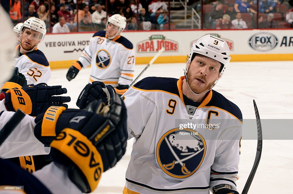 <a gi-track='captionPersonalityLinkClicked' href=/galleries/search?phrase=Steve+Ott&family=editorial&specificpeople=210616 ng-click='$event.stopPropagation()'>Steve Ott</a> #9 of the Buffalo Sabres is congratulated by teammates after his second period goal against the Phoenix Coyotes at Jobing.com Arena on January 30, 2014 in Glendale, Arizona.
