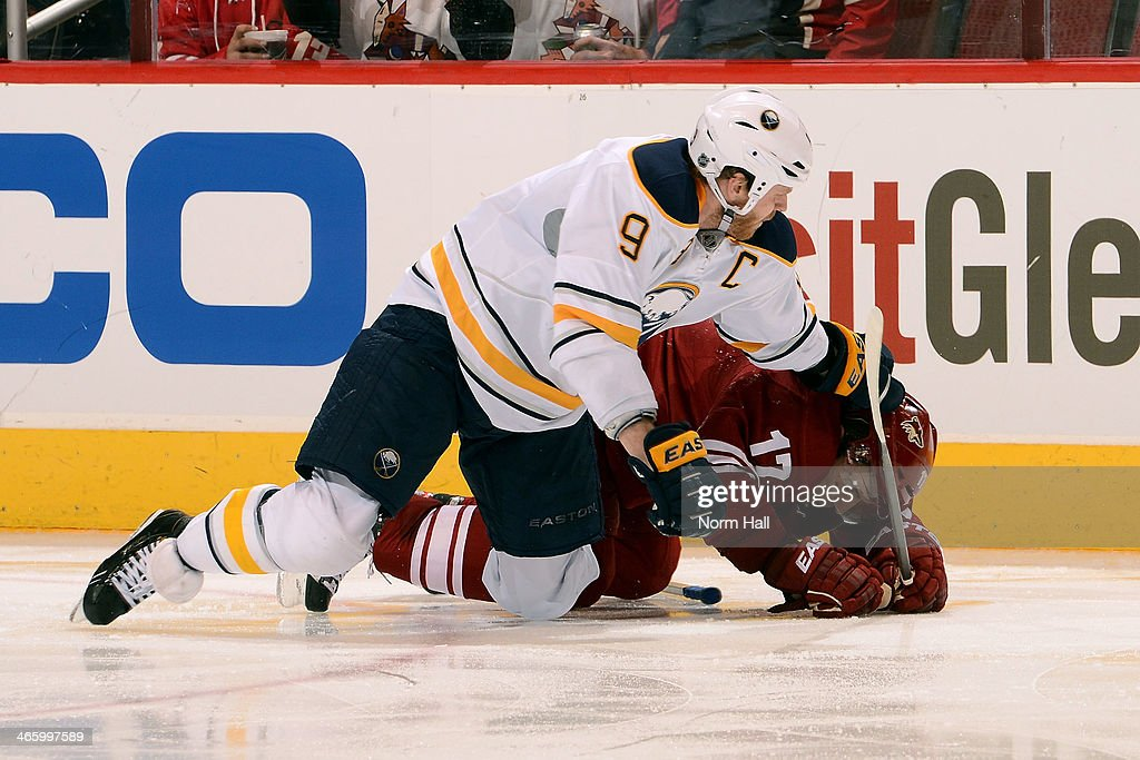 <a gi-track='captionPersonalityLinkClicked' href=/galleries/search?phrase=Steve+Ott&family=editorial&specificpeople=210616 ng-click='$event.stopPropagation()'>Steve Ott</a> #9 of the Buffalo Sabres knocks <a gi-track='captionPersonalityLinkClicked' href=/galleries/search?phrase=Radim+Vrbata&family=editorial&specificpeople=204716 ng-click='$event.stopPropagation()'>Radim Vrbata</a> #17 of the Phoenix Coyotes to the ice during the third period at Jobing.com Arena on January 30, 2014 in Glendale, Arizona.