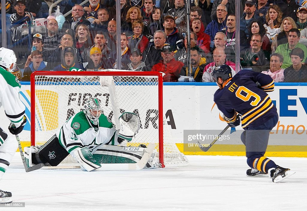 <a gi-track='captionPersonalityLinkClicked' href=/galleries/search?phrase=Steve+Ott&family=editorial&specificpeople=210616 ng-click='$event.stopPropagation()'>Steve Ott</a> #9 of the Buffalo Sabres scores a second period shot against <a gi-track='captionPersonalityLinkClicked' href=/galleries/search?phrase=Kari+Lehtonen&family=editorial&specificpeople=211612 ng-click='$event.stopPropagation()'>Kari Lehtonen</a> #32 of the Dallas Stars on October 28, 2013 at the First Niagara Center in Buffalo, New York.