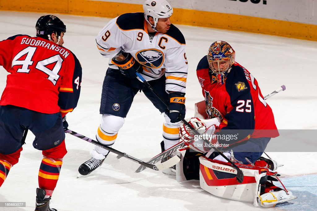 <a gi-track='captionPersonalityLinkClicked' href=/galleries/search?phrase=Steve+Ott&family=editorial&specificpeople=210616 ng-click='$event.stopPropagation()'>Steve Ott</a> #9 of the Buffalo Sabres shoots and scores against Goaltender <a gi-track='captionPersonalityLinkClicked' href=/galleries/search?phrase=Jacob+Markstrom&family=editorial&specificpeople=5370948 ng-click='$event.stopPropagation()'>Jacob Markstrom</a> #25 of the Florida Panthers at the BB&T Center on October 25, 2013 in Sunrise, Florida.