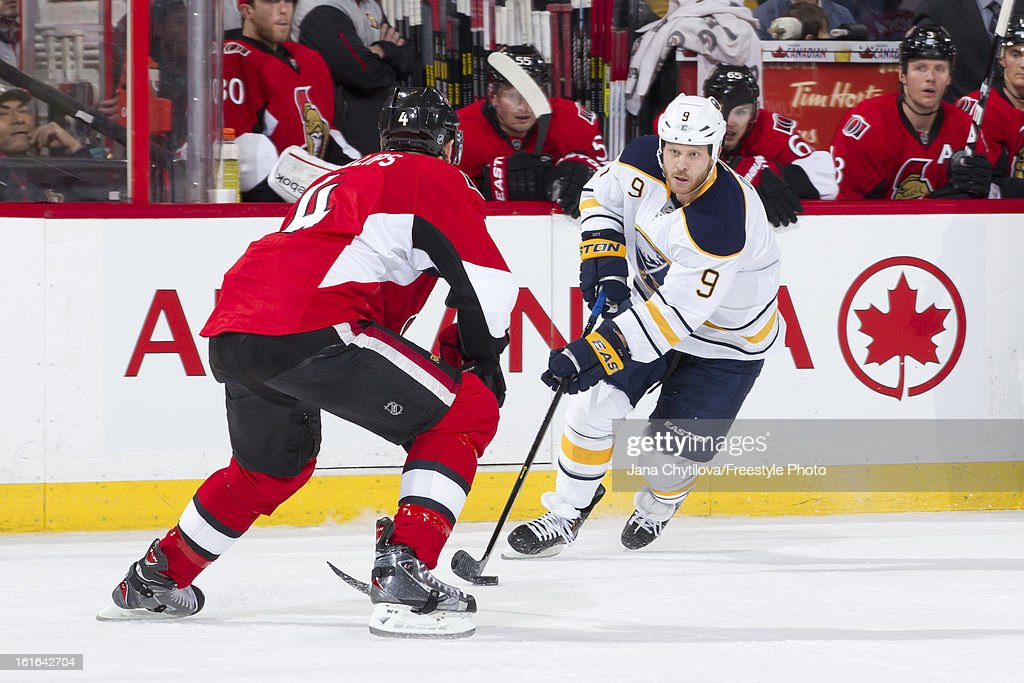 <a gi-track='captionPersonalityLinkClicked' href=/galleries/search?phrase=Steve+Ott&family=editorial&specificpeople=210616 ng-click='$event.stopPropagation()'>Steve Ott</a> #9 of the Buffalo Sabres shoots the puck against Chris Phillips #4 of the Ottawa Senators, during an NHL game at Scotiabank Place on February 12, 2013 in Ottawa, Ontario, Canada.