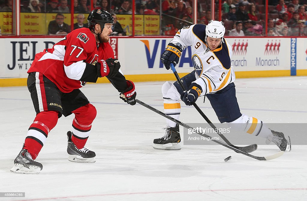 <a gi-track='captionPersonalityLinkClicked' href=/galleries/search?phrase=Steve+Ott&family=editorial&specificpeople=210616 ng-click='$event.stopPropagation()'>Steve Ott</a> #9 of the Buffalo Sabres shoots the puck against <a gi-track='captionPersonalityLinkClicked' href=/galleries/search?phrase=Joe+Corvo&family=editorial&specificpeople=206339 ng-click='$event.stopPropagation()'>Joe Corvo</a> #77 of the Ottawa Senators at Canadian Tire Centre on December 12, 2013 in Ottawa, Ontario, Canada.