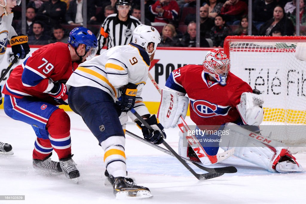 <a gi-track='captionPersonalityLinkClicked' href=/galleries/search?phrase=Steve+Ott&family=editorial&specificpeople=210616 ng-click='$event.stopPropagation()'>Steve Ott</a> #9 of the Buffalo Sabres shoots the puck past <a gi-track='captionPersonalityLinkClicked' href=/galleries/search?phrase=Carey+Price&family=editorial&specificpeople=2222083 ng-click='$event.stopPropagation()'>Carey Price</a> #31 of the Montreal Canadiens to score the game winning goal in overtime during the NHL game at the Bell Centre on March 19, 2013 in Montreal, Quebec, Canada. The Sabres defeated the Canadiens 3-2 in overtime.