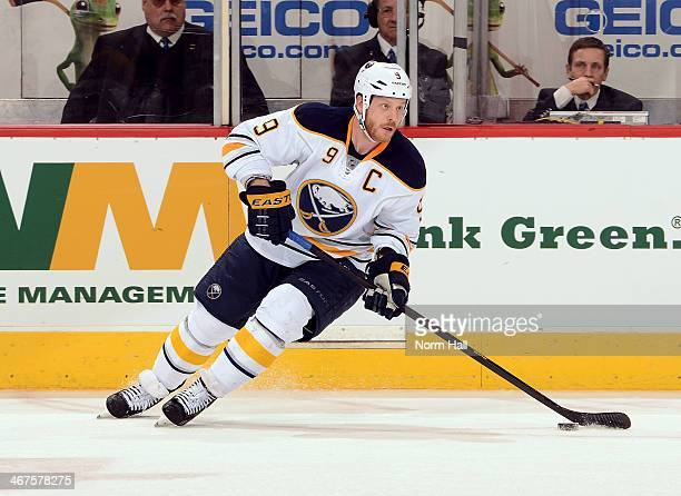 Steve Ott of the Buffalo Sabres skates with the puck against the Phoenix Coyotes at Jobingcom Arena on January 30 2014 in Glendale Arizona